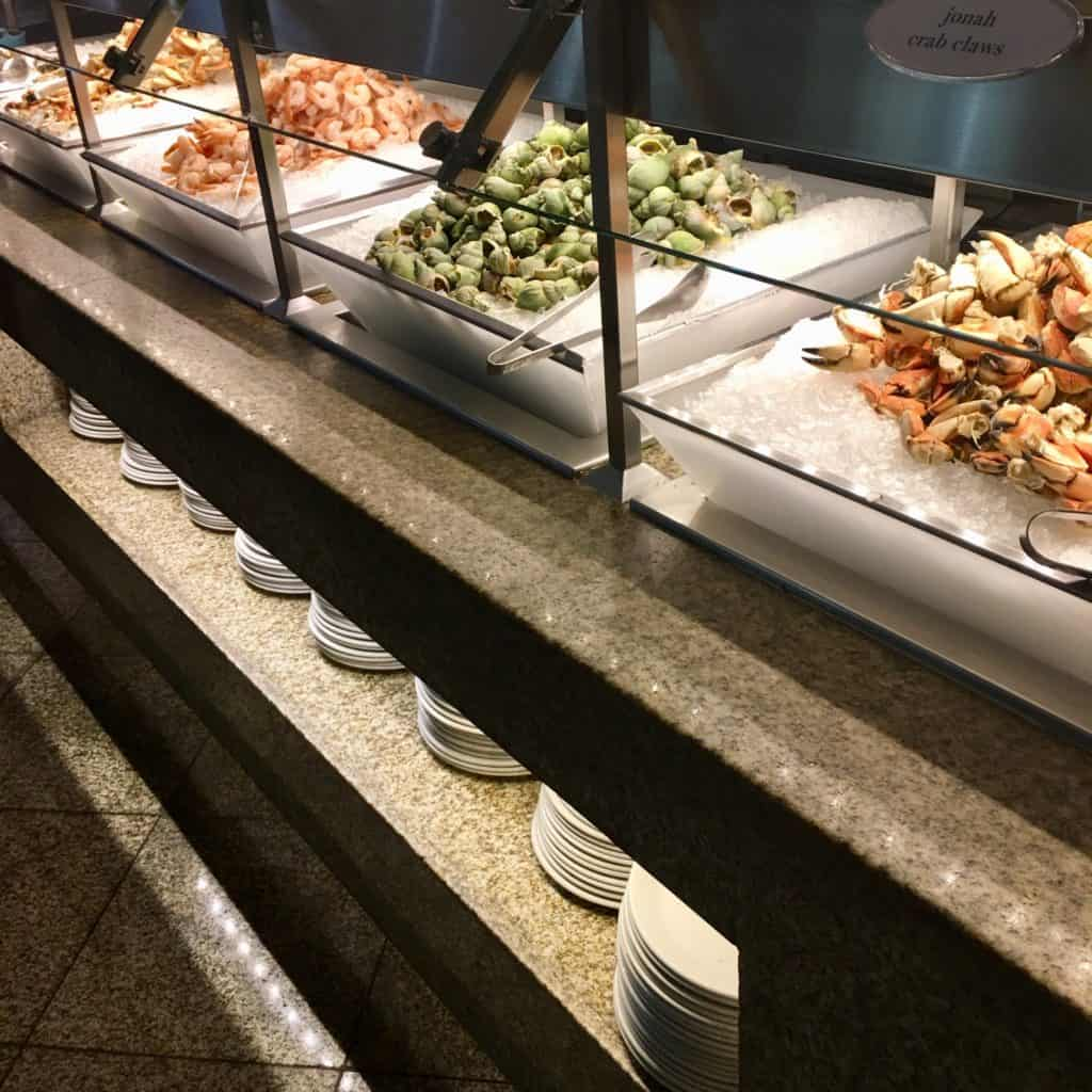 Seafood station at Bacchanal with crab legs, snails, and shirmp