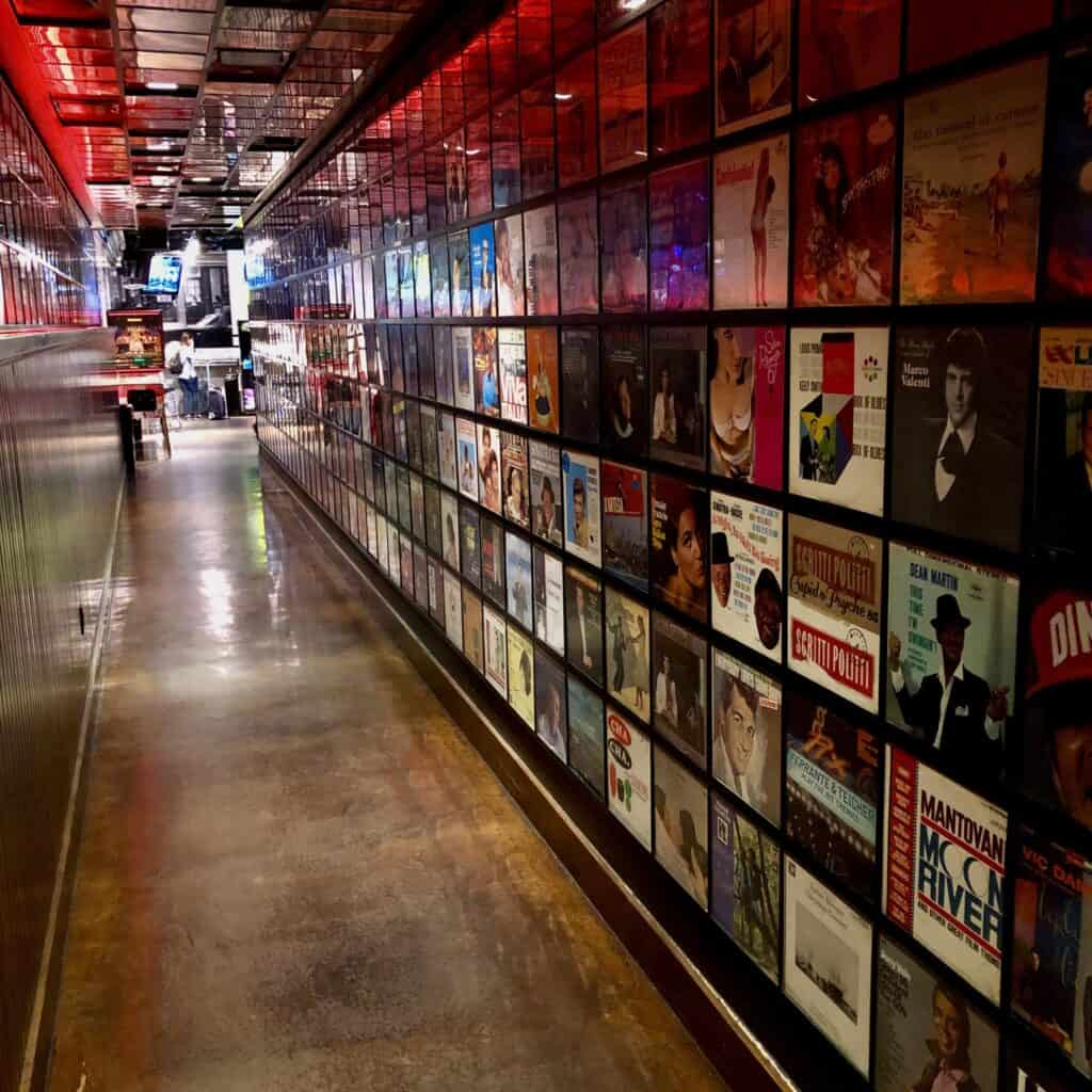Hallway lined with records leading to Secret Pizza