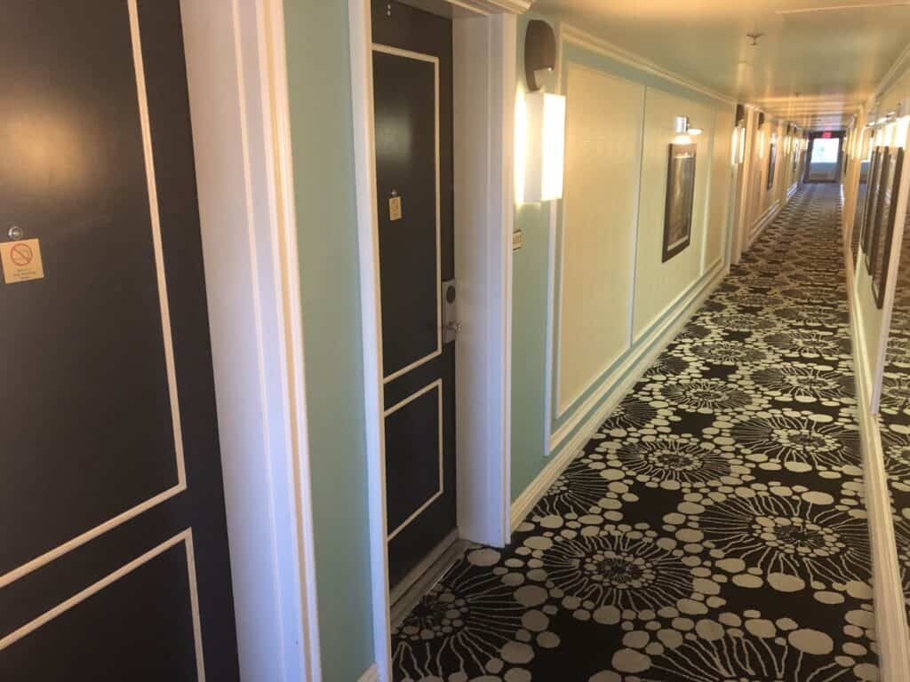 Hotel hallway with floral carpet