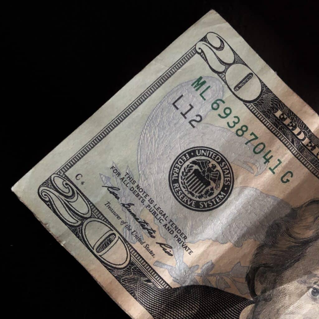 $20 bill with a dark background