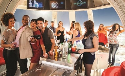Group of people enjoying drinks on the High Roller