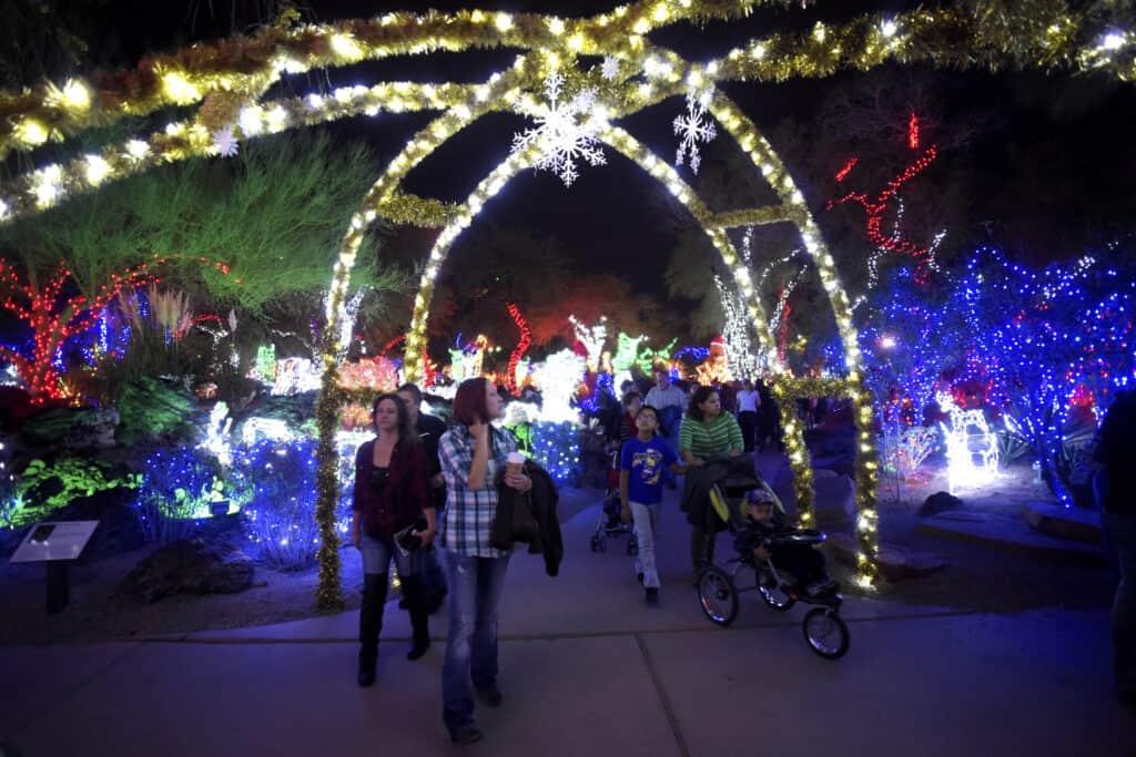 People walking through illuminated decor in The Park