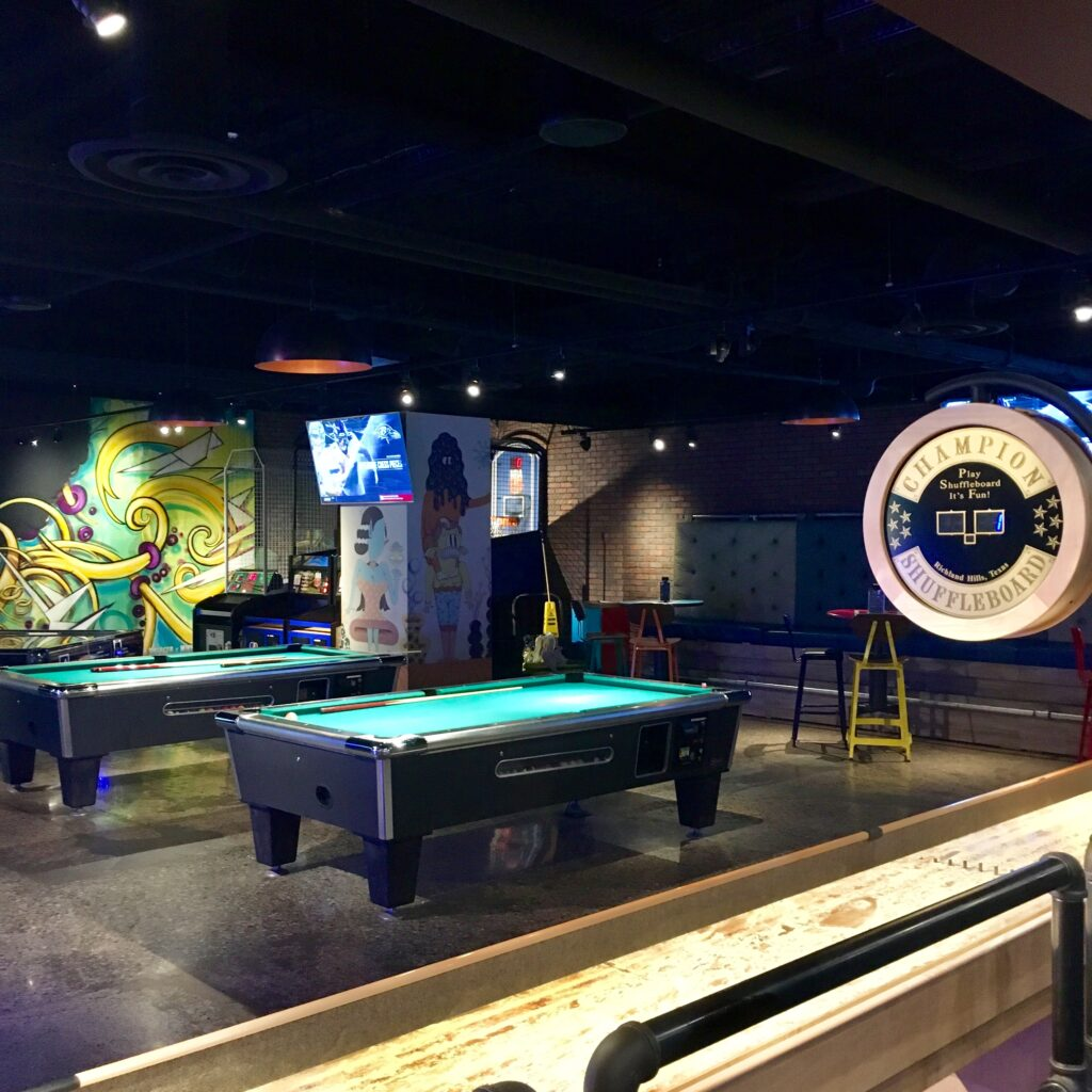 Shuffleboard and pool tables at Level Up