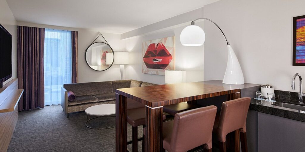 Sectional Couch and dining table in Linq's King Suite