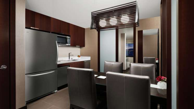 Fridge, Microwave and table in the kitchenette