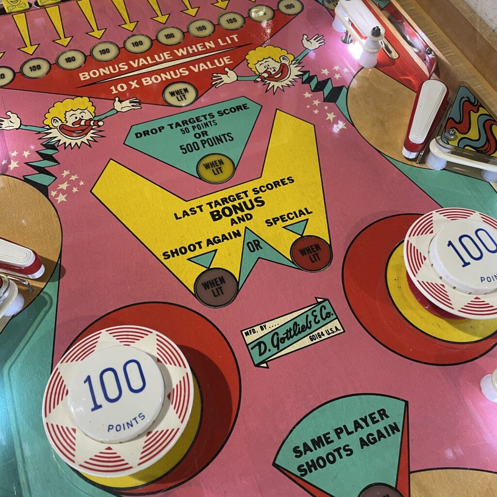 Pinball machine bumpers on a historic game