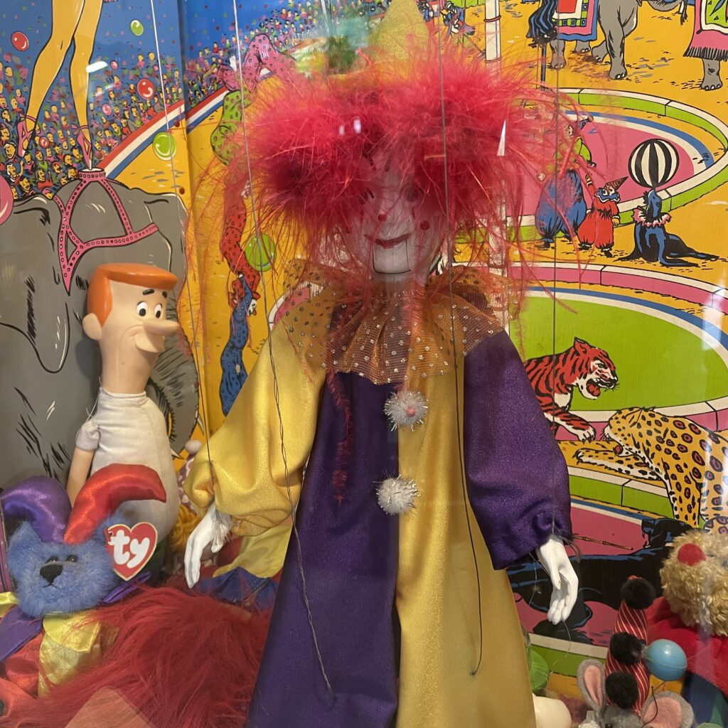 clown with red, crazy hair at the Pinball Hall of Fame