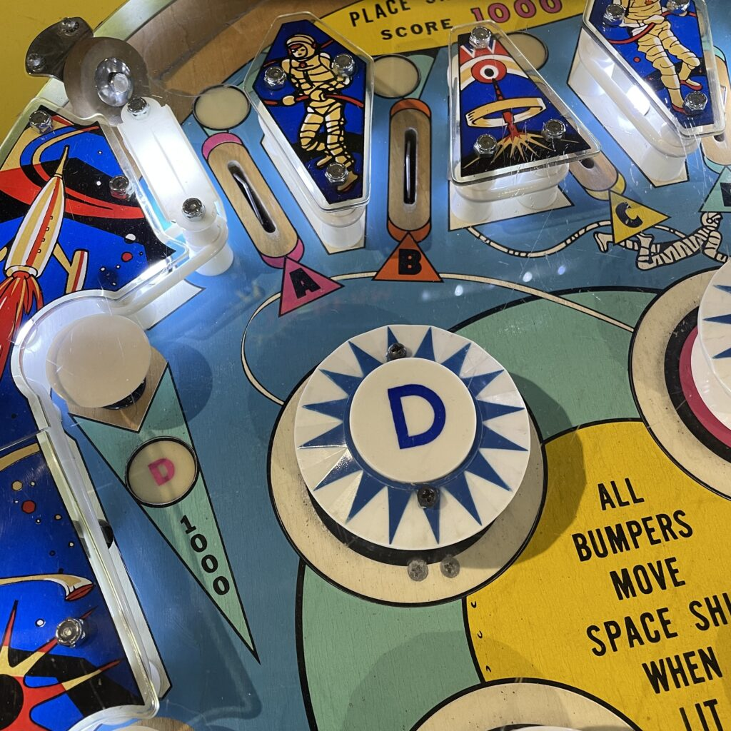 Bumpers and lights on a pinball machine