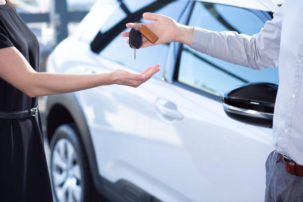 Keys being handed over for a rental car