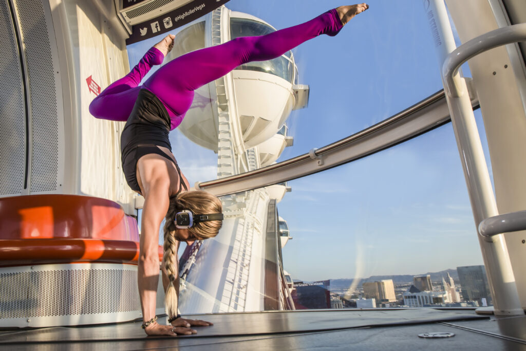 Woman doing yoga pose on High Roller Observation Wheel
