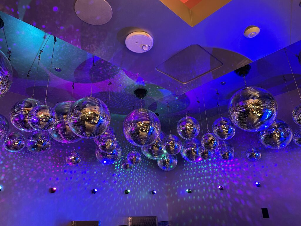 Disco Balls hanging from the ceiling in the bathroom