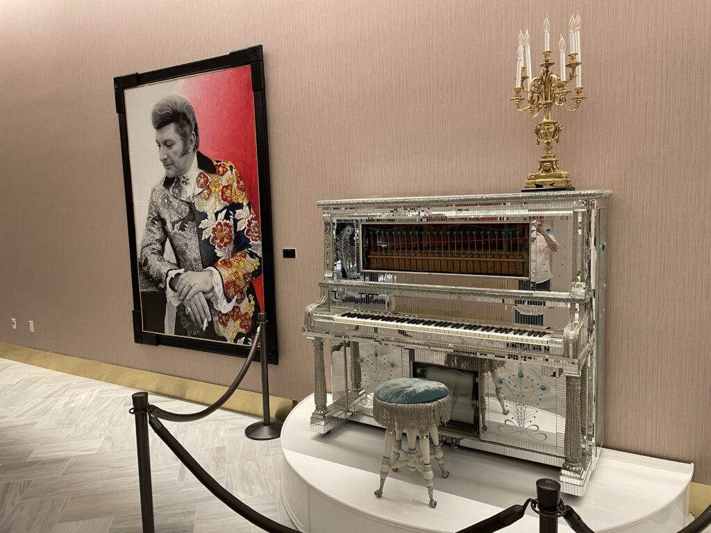 Liberace mural and piano