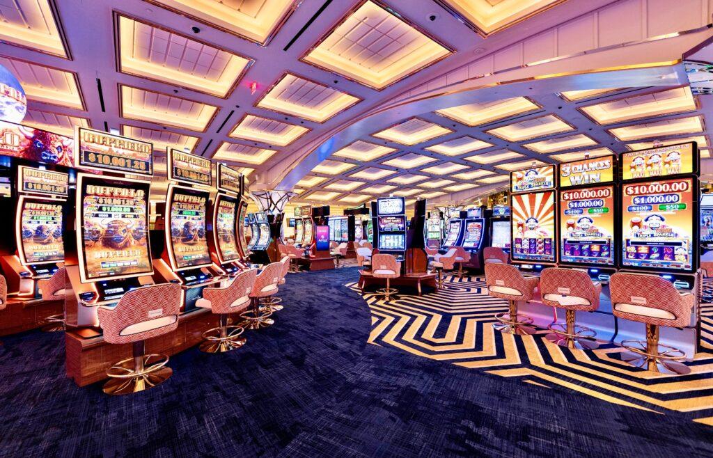 Slot machines lining Resorts World's gaming floor.