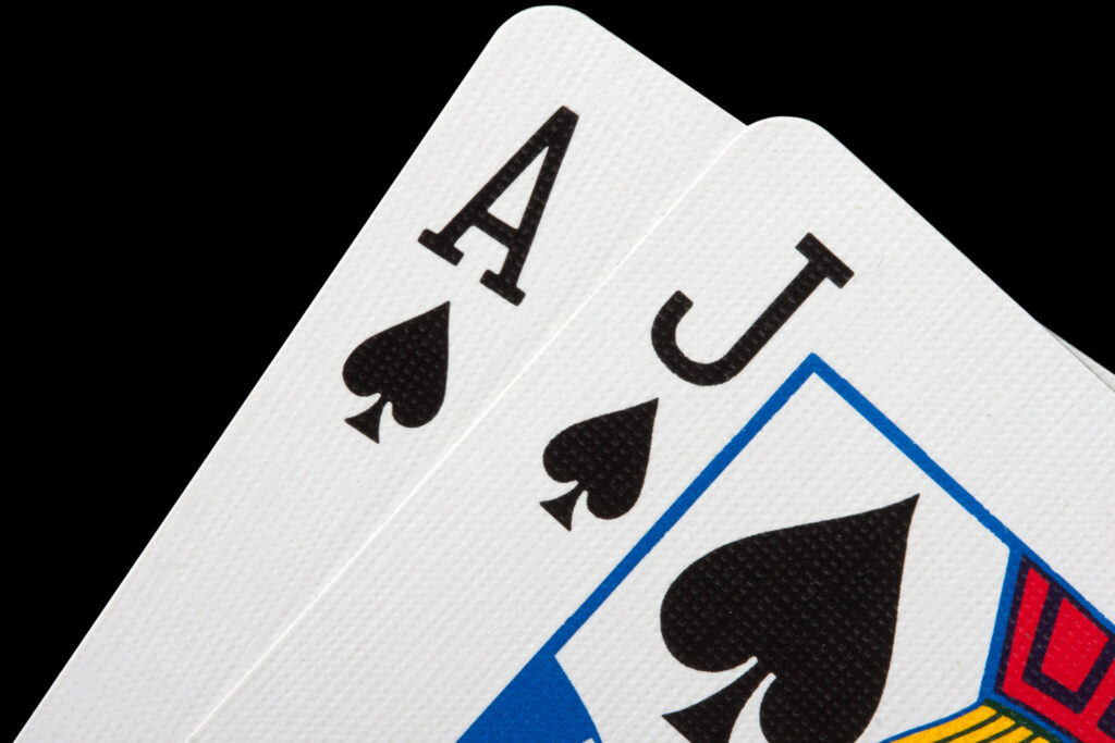Blackjack comprised of an Ace and jack of spades