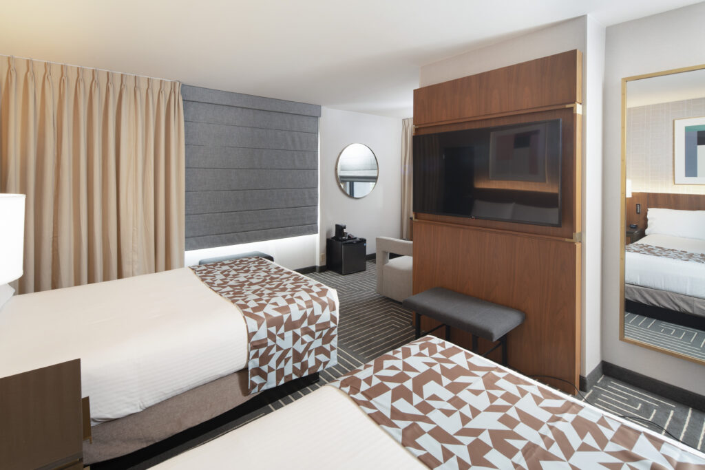 Beds and TV in a Renovated Fremont Hotel Room