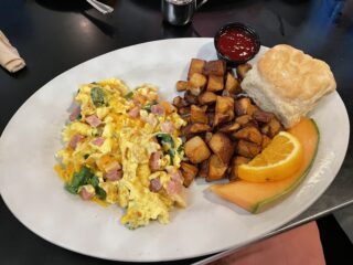 Ham, Egg, and Cheese Scrambler, cubed potatos, a biscuit, and fruit