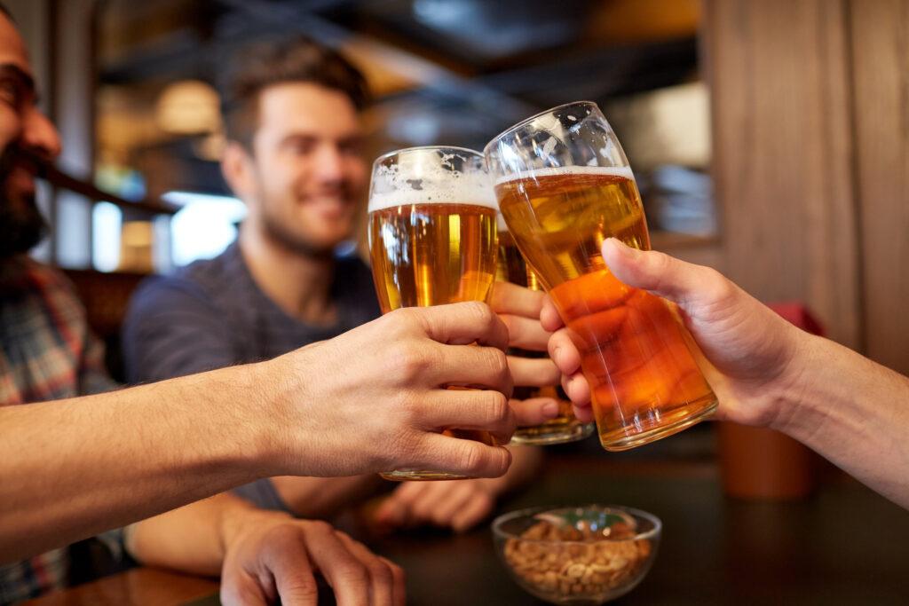 Men clinking beers together