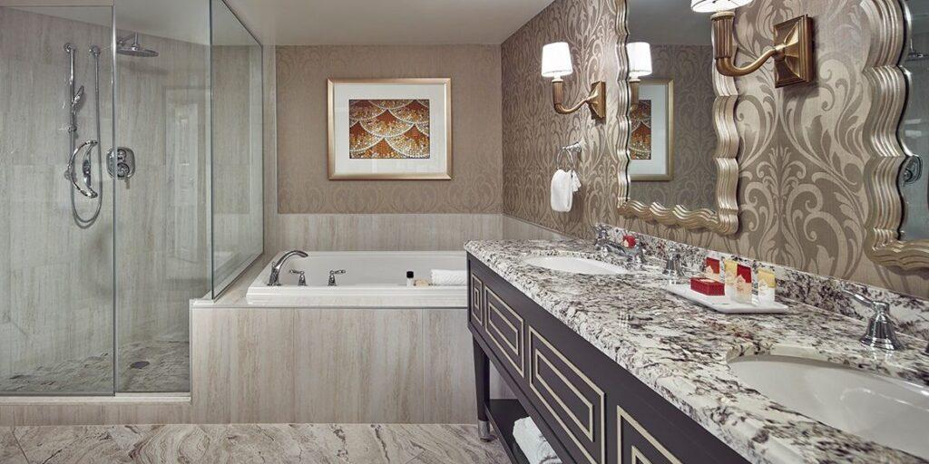 2 person Tub behind the 2 sink bathroom vanity