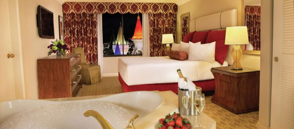 Tub and Bedroom in the Royal Luxury Suite