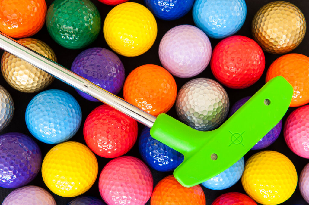 colorful mini golf balls and putter
