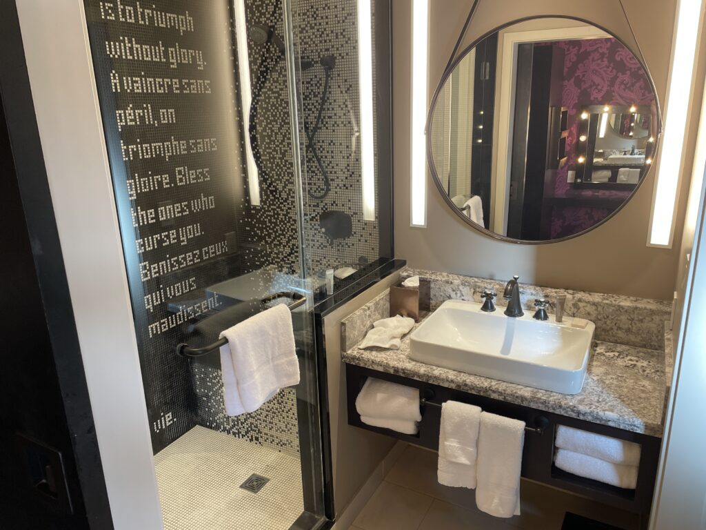 Vanity and shower in the Luxury King Room
