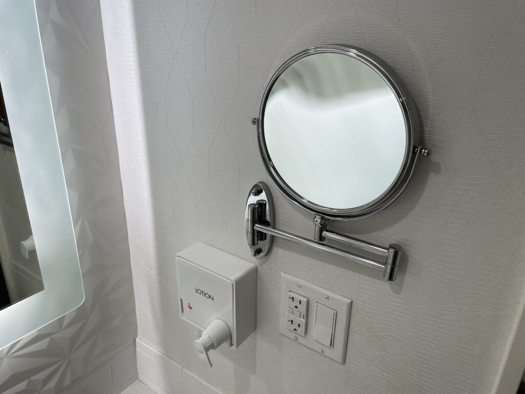 Lotion dispenser and personal mirror